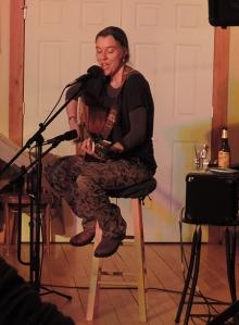 Kat Mills with guitar